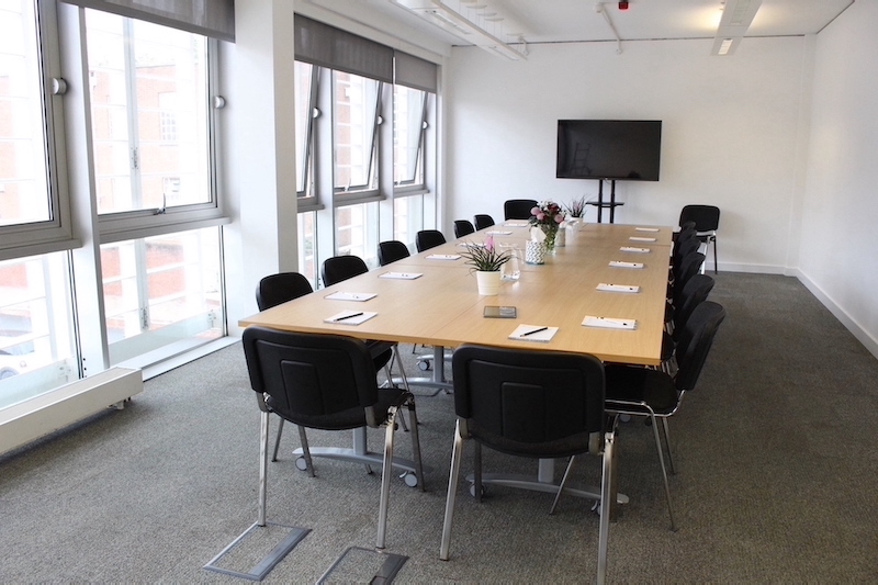 Elm Room in boardroom layout overlooking the terrace and car park